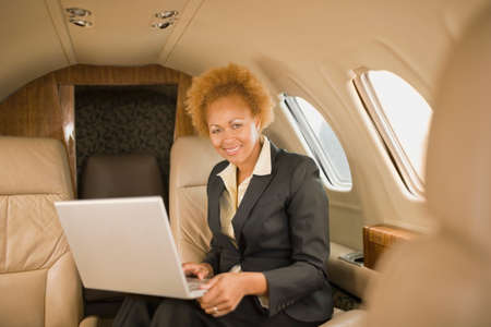 ostentatious: African American businesswoman on airplane