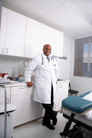 African American male doctor in examining room Banco de Imagens