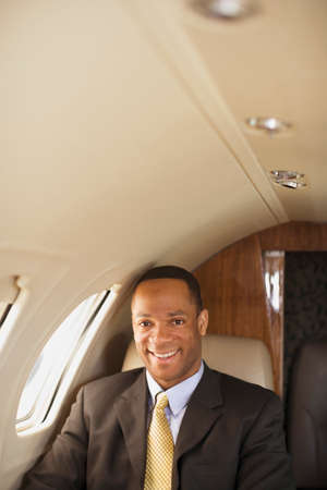 African American businessman on airplane Stock Photo