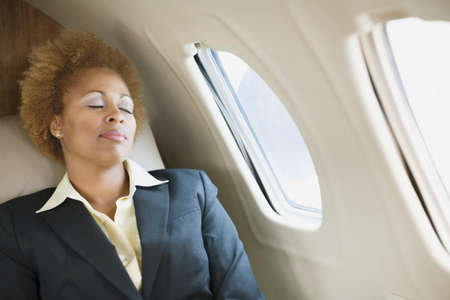 ostentatious: African American businesswoman sleeping on airplane
