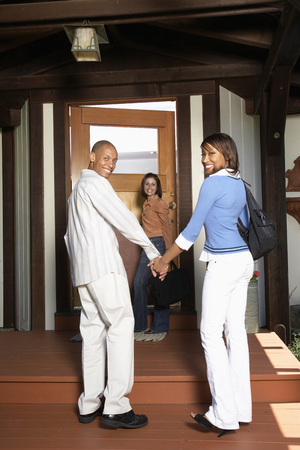 African American couple entering house Stock Photo