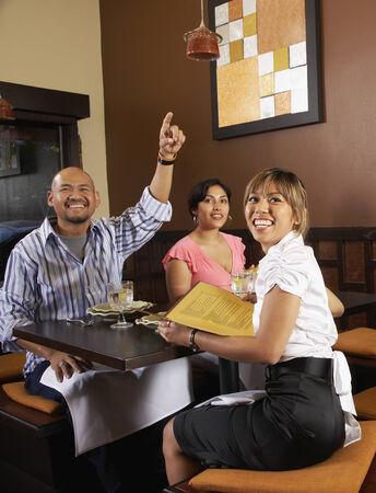 blabbing: Multi-ethnic friends at restaurant