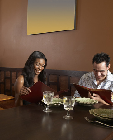 entertaining area: Multi-ethnic friends at restaurant