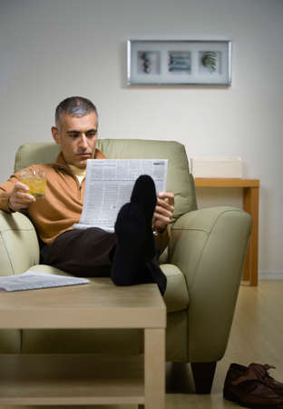 middle eastern: Middle Eastern man reading newspaper
