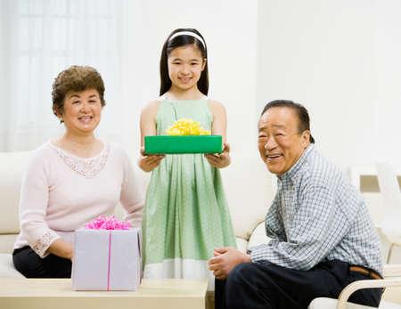 grampa: Asian girl holding gift
