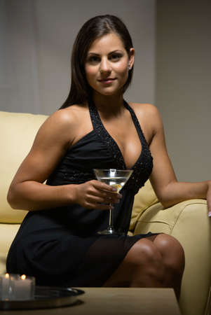 interrogating: Woman in evening gown holding cocktail