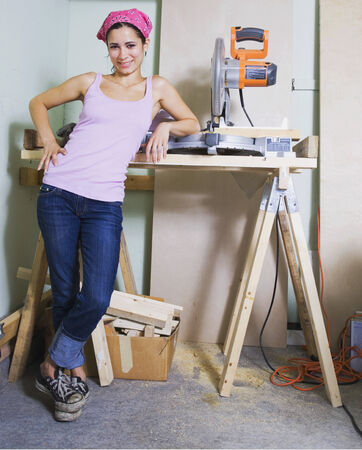 topsyturvy: Middle Eastern woman next to table saw