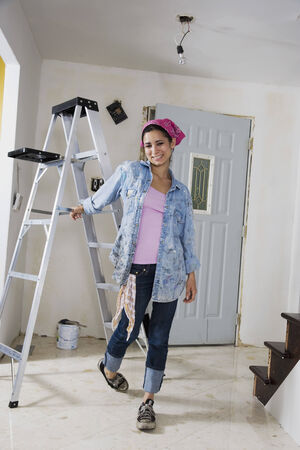 middle eastern: Middle Eastern woman next to ladder