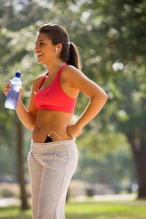 attired: Hispanic woman wearing athletic gear