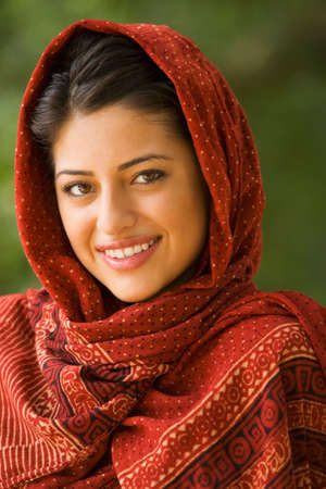 attired: Portrait of Indian woman wearing head scarf LANG_EVOIMAGES