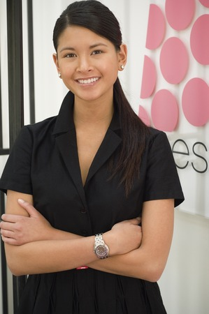 multiple ethnicities: Asian woman with arms crossed LANG_EVOIMAGES