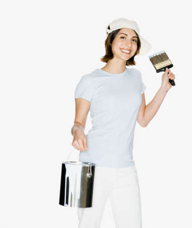 panache: Mixed Race woman holding paint can and paint brush