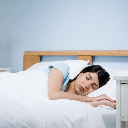 bodyart: Mixed Race woman sleeping in bed