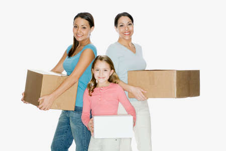 giver: Hispanic mother and daughters holding moving boxes