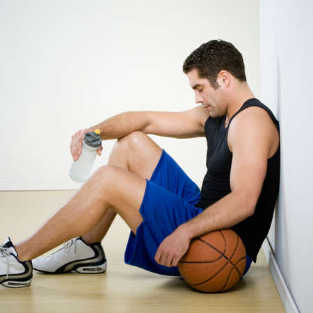 athletic gear: Hispanic man in athletic gear with basketball