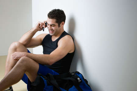 athletic gear: Hispanic man in athletic gear talking on cell phone