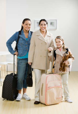 davenport: Hispanic mother and daughters with suitcases