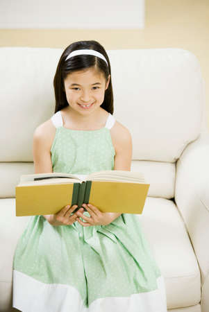 commercialism: Asian girl reading book