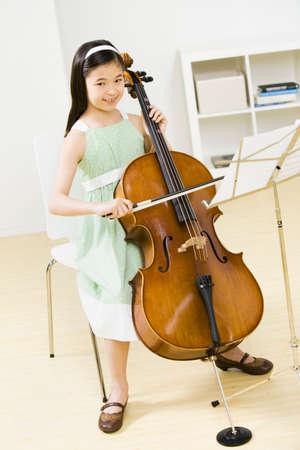 gramma: Asian girl playing cello