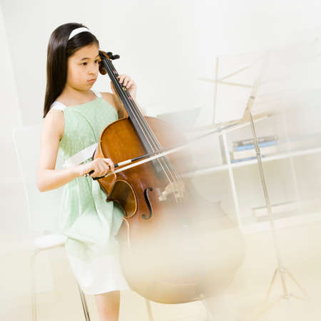 sheet music: Asian girl playing cello