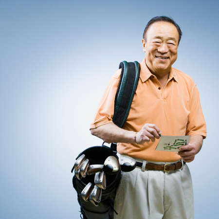 solicitous: Senior Asian man carrying golf bag