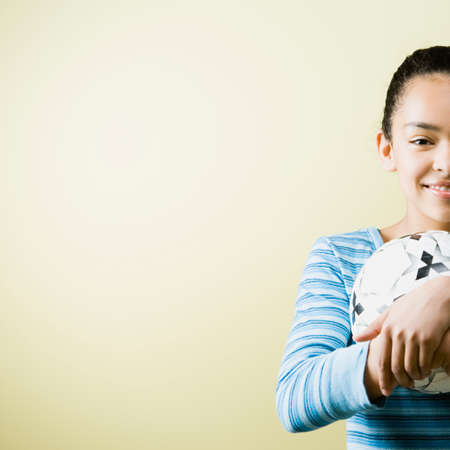 africanamerican: Mixed Race teenage girl holding soccer ball