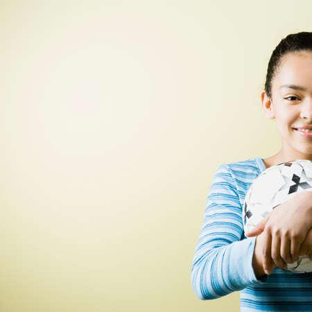 davenport: Mixed Race teenage girl holding soccer ball