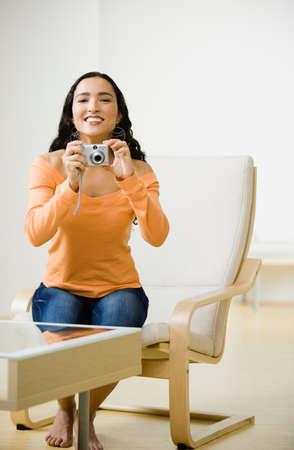 davenport: Hispanic woman taking photograph
