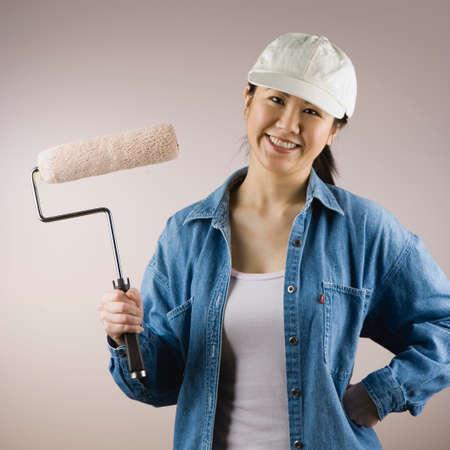 davenport: Asian woman holding paint roller