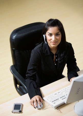searcher: Indian businesswoman wearing headset