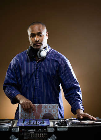 turntables: African American male dj behind turntables