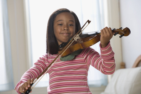 African American girl playing violin