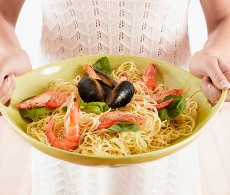 eagerness: Close up of plate of seafood pasta