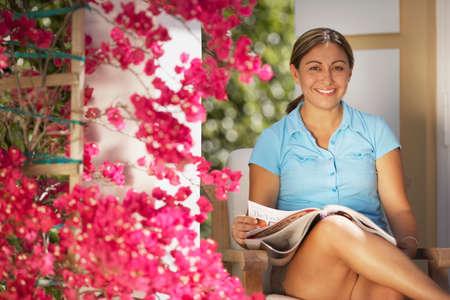 blabbing: Woman reading magazine outdoors