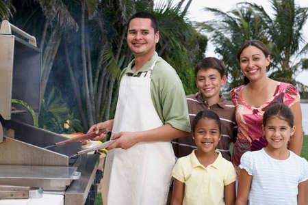 barbequing: Multi-ethnic family barbequing