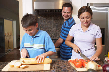 Multi-ethnic family preparing food Stock Photo