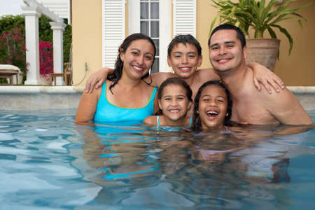 family looking up: Multi-ethnic family in swimming pool