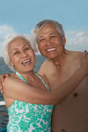 poised: Senior Asian couple hugging