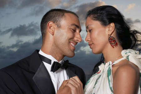 nite: Hispanic couple smiling at each other