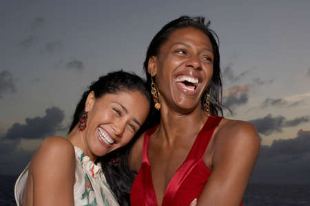 ostentatious: Multi-ethnic women laughing