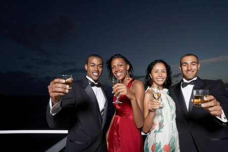ostentatious: Multi-ethnic couples toasting