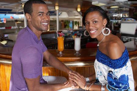 bathingsuit: Multi-ethnic couple at bar LANG_EVOIMAGES
