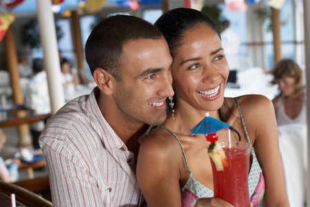 relishing: Hispanic couple hugging