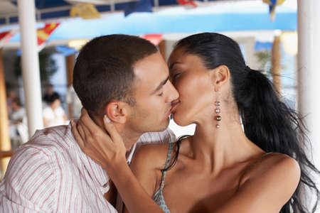 alehouse: Hispanic couple kissing