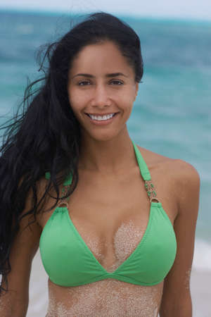 bathingsuit: Sandy Hispanic woman in bikini LANG_EVOIMAGES