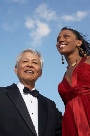 Low angle view of Mixed Race woman and senior man Stock Photo