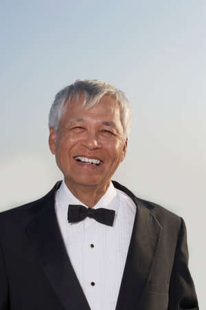 ostentatious: Senior Pacific Islander man wearing tuxedo LANG_EVOIMAGES
