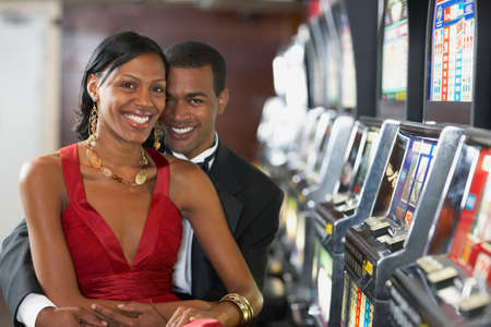 ostentatious: Couple next to slot machines LANG_EVOIMAGES