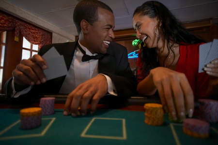 ostentatious: Multi-ethnic couple gambling