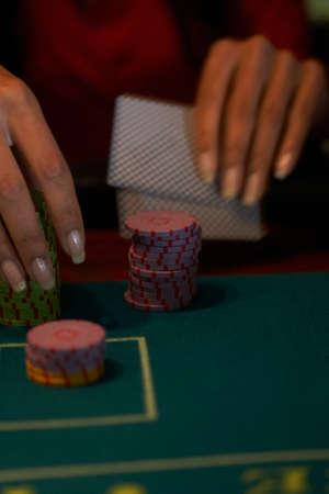 low spirited: Close up of Hispanic woman gambling